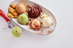 Scoops of Assorted Ice Cream Flavors on Platter royalty free stock images