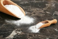 Scoops with baking soda. On dark table stock image