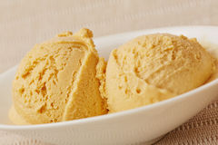 Scoops of caramel ice cream Royalty Free Stock Photo