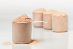 Scoops of chocolate whey isolate protein Stock Photography