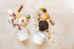 Scoops of ice cream and ingredients with enamel mugs, flat lay Royalty Free Stock Images
