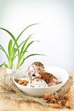 Scoops of ice cream with nuts and chocolate Stock Image