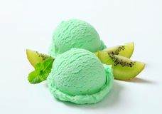 Scoops of light green ice cream. And fresh kiwi stock photography