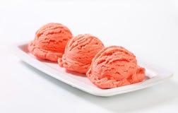 Scoops of pink fruit sherbet Stock Image