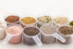 Scoops of seeds and powders Royalty Free Stock Photography