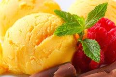 Scoops of yellow ice cream Stock Photo