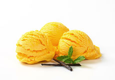 Scoops of yellow ice cream Stock Photo