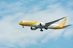 Scoot Airline Airplane Landing à l'International de Singapour Changi photographie stock