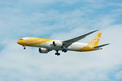 Scoot Airline Airplane Landing à l'International de Singapour Changi image libre de droits