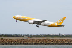 Scoot Airlines Boeing 777 jet taking off. Scoot Airlines Boeing 777 jet airliner taking off, amid reports the airline will move to a fleet of Boeing 787 Royalty Free Stock Photos