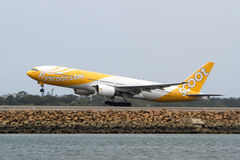 Scoot Airlines Boeing 777 jet taking off. Stock Photo