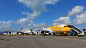 Scoot Boeing 787 Dreamliner in front of Qatar Airways Airbus A380 at Singapore Airshow Royalty Free Stock Image