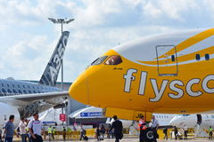 Scoot Boeing 787 Dreamliner parked next to rival Airbus A350-900 XWB at Singapore Airshow Stock Photos