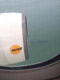 Scoot Budget Airlines. A photo of airplanes engine with shadow of the aircraft Stock Image