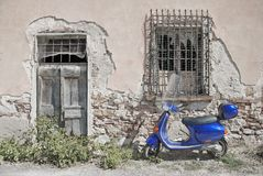Scooter. Vintage image of blue Italian scooter in Roma, Italia Stock Photography