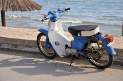 Scooter. Picture of retro scooter next to the beach Royalty Free Stock Image