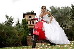 Scooter. A bride sitting on a red scooter Stock Photos