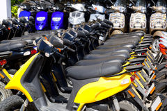 Scooter bikes in rental shop in a row Royalty Free Stock Photos