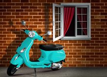 Scooter with Brick Wall Background Stock Image