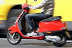 Scooter in the city Royalty Free Stock Images