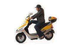 Scooter d'équitation de femme Photographie stock libre de droits