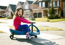 Scooter d'équitation de fille Photos stock