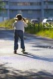 Scooter d'équitation de petite fille Photo libre de droits