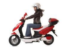 Scooter d'équitation de femme Photographie stock