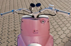 Scooter dashboard. Pink scooter parking on the street Royalty Free Stock Image