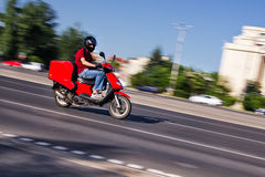 Scooter delivery man Stock Photos