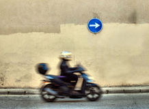 Scooter driver in motion Royalty Free Stock Photography
