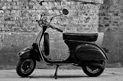 Scooter in front of a wall Stock Photography