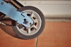 Scooter front wheel next to a wall royalty free stock photos