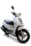 Scooter. Modern white scooter side view WITH parking stand and realistic shadows over a white background - Includes separate clipping paths Royalty Free Stock Photo