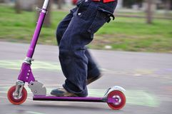 Scooter in motion Royalty Free Stock Image
