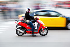 Scooter in motion blur Royalty Free Stock Images