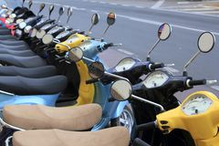 Scooter mototbikes row many in rent store. Scooter motorbikes row many in rent store Royalty Free Stock Photos