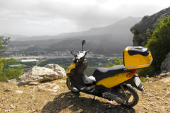 Scooter in mountains Royalty Free Stock Image