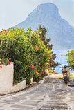 Scooter on narrow Greek Kalymnos island street Stock Images
