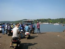 Scooter over the river. Waiting for the ferry to cross river in Goa, India Royalty Free Stock Image