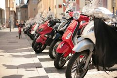 Scooter parking. Italian scooter parking on the city street Royalty Free Stock Photo