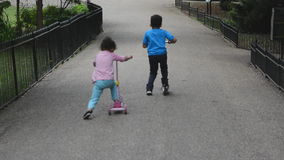Children Scooter race stock footage