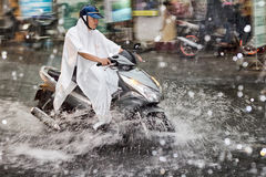 Scooter in the rain Stock Image