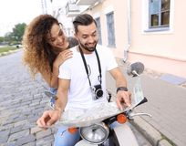 Scooter ride. Beautiful couple riding scooter together. Stock Photos