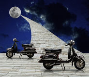 Scooter ride to the moon Stock Photos