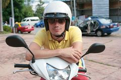 Scooter rider. Young man on a scooter wearing sunglasses Stock Photo