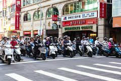 Scooter Riders During Morning Commute in Taipei, Taiwan Royalty Free Stock Photos