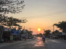 Scooter running on road at sunset in Phu Quoc, Vietnam Royalty Free Stock Photography