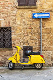 Scooter and sign. Showing the direction of travel Royalty Free Stock Images