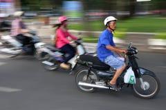 A scooter speeds through the streets of Hanoi, Vietnam Stock Photos